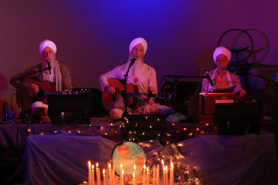 3 Members of the Khalsa Healing group performing a song