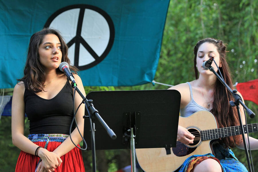 Two females performing a song