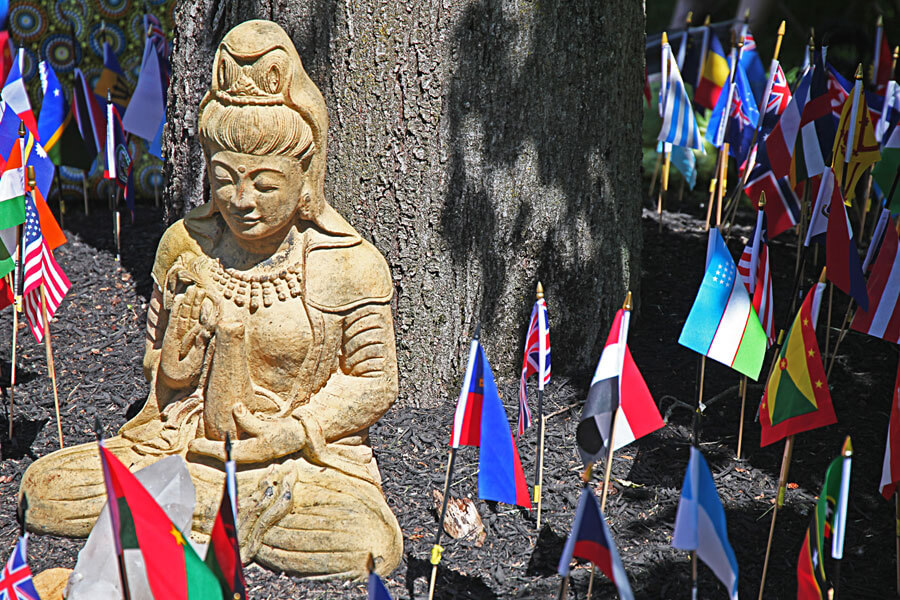 A statue with serveral flags surrounding it