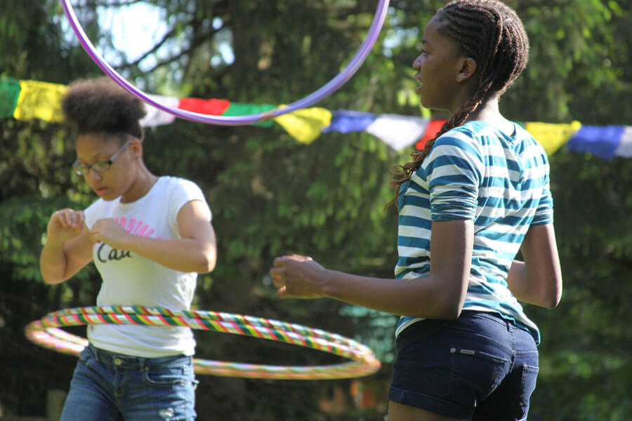 Two girls playing with hula-hoops