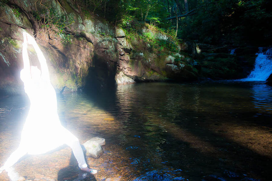 Meditating by a waterfall